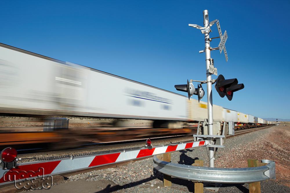 Train passing level crossing motion blur