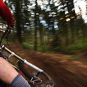 Owen Dudley rides through a mist laiden forest to capture a POV image near Bellingham Washington.