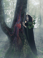 Woman druid in the forest listening to the heartbeat of a tree, artistic conceptual photo illustration.