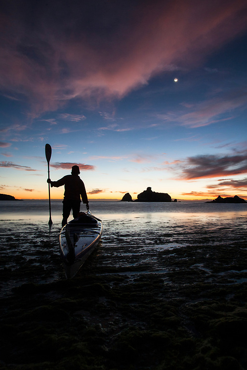 Young male kayaker at twilight on the Sea of Cortez, Mexico.