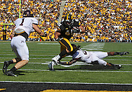 September 29 2012: Iowa Hawkeyes running back Mark Weisman (45) tries to avoid Minnesota Golden Gophers linebacker Brendan Beal (1) and defensive back Troy Stoudermire (2) on a run to the half yard line during the second quarter of the NCAA football game between the Minnesota Golden Gophers and the Iowa Hawkeyes at Kinnick Stadium in Iowa City, Iowa on Saturday September 29, 2012. Iowa defeated Minnesota 31-13 to claim the Floyd of Rosedale Trophy.