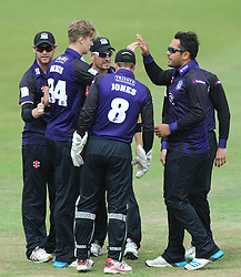 Craig Miles of Gloucestershire celebrates with team mates as he bowls out Michael Carberry of Hampshire for 12  - Photo mandatory by-line: Dougie Allward/JMP - Mobile: 07966 386802 - 14/07/2015 - SPORT - Cricket - Cheltenham - Cheltenham College - Natwest T20 Blast