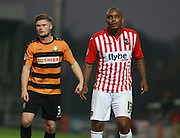 Barnet defender Elliott Johnson keeps tight to Exeter City striker Clinton Morrison   during the Sky Bet League 2 match between Barnet and Exeter City at The Hive Stadium, London, England on 31 October 2015. Photo by Bennett Dean.