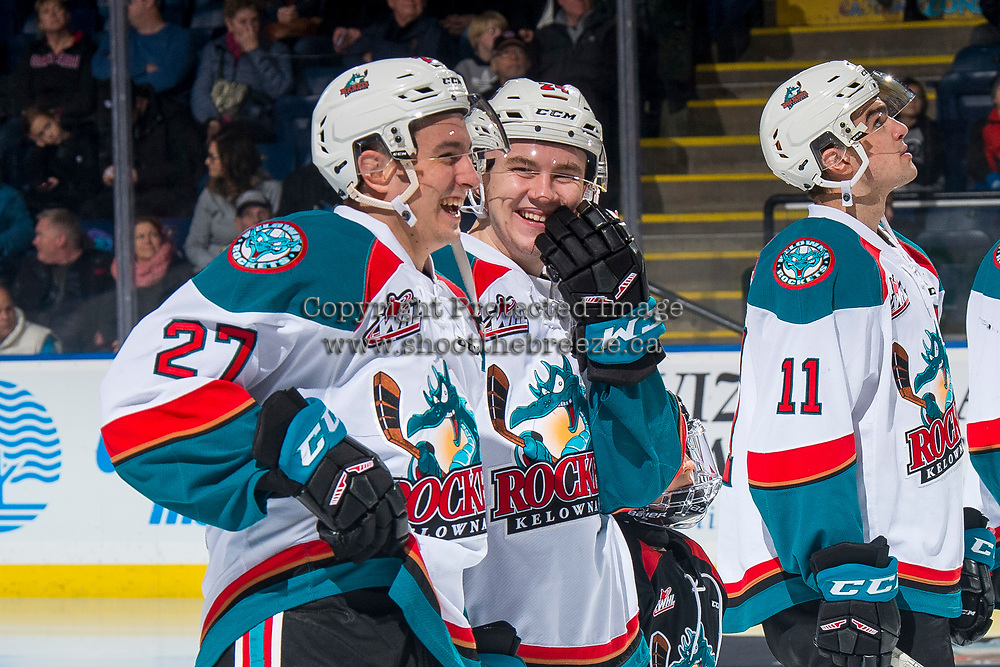 KELOWNA, CANADA - JANUARY 4: Lane Zablocki #27 and Kyle Topping #24 of the Kelowna Rockets share a laugh on the ice against the Prince George Cougars on January 4, 2019 at Prospera Place in Kelowna, British Columbia, Canada.  (Photo by Marissa Baecker/Shoot the Breeze)