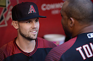 PHOENIX, AZ - APRIL 08:  Chris Owings #16 of the Arizona Diamondbacks talks with Yasmany Tomas #24 in the MLB game against the Cleveland Indians at Chase Field on April 8, 2017 in Phoenix, Arizona. The Arizona Diamondbacks won 11-2.  (Photo by Jennifer Stewart/Getty Images)