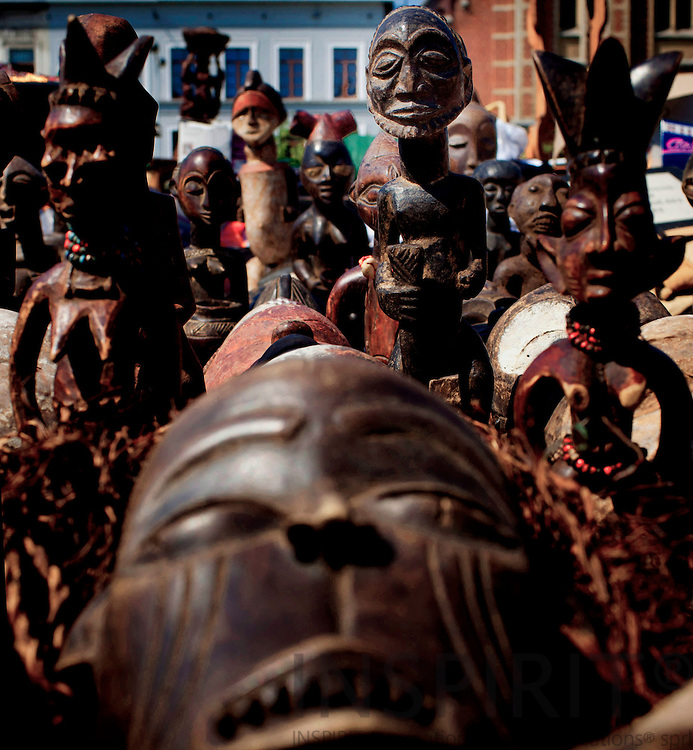 African mask for sale at the second hand and flea market of the Marolles at Place Jeu de Balle in Brussels Easter Saturday 23 April 2011. Photo: Erik Luntang / INSPIRIT Photo