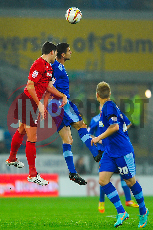Cardiff Defender Mark Hudson (ENG) heads in the air during the first half of the match - Photo mandatory by-line: Rogan Thomson/JMP - Tel: Mobile: 07966 386802 23/10/2012 - SPORT - FOOTBALL - Cardiff City Stadium - Cardiff. Cardiff City v Watford - Football League Championship