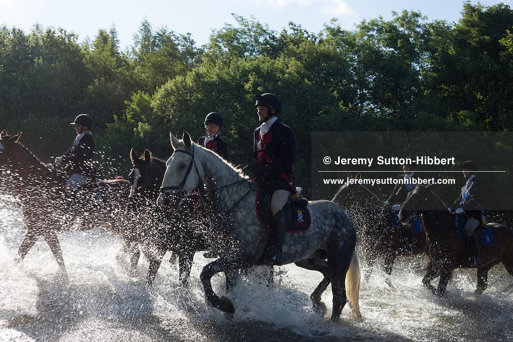 Horsemen, led by Standard Bearer Martin Rodgerson, cross the River Ettrick, at the start of the Common Riding festivities in Selkirk, with Royal Burgh Standard Bearer Martin Rodgerson, in Selkirk, Scotland, Friday 14th June 2013. <br /> N55&deg;33.311'<br /> W2&deg;50.634'