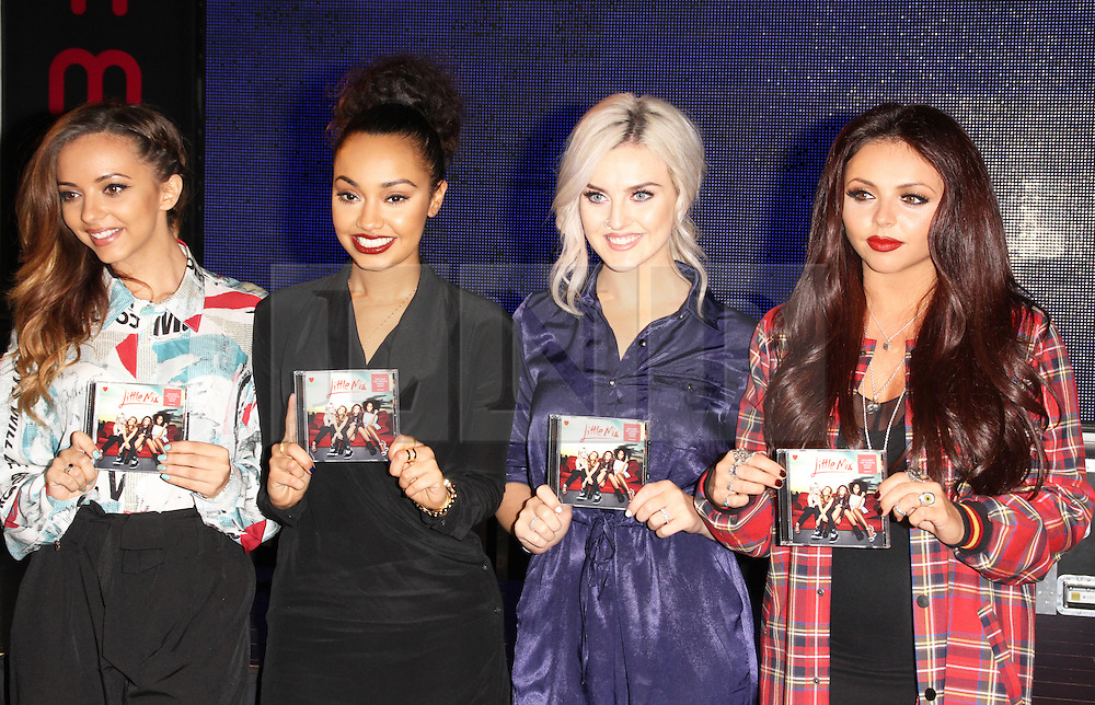 Little Mix: Salute Album Signing, HMV Oxford Circus, London UK, November 11 2013, Photo by Brett Cove © Licensed to London News Pictures. Photo credit : Brett D. Cove/Piqtured/LNP