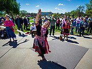 04 MAY 2017 - ST. PAUL, MN: A woman prays and dances during a prayer service at the Minnesota State Capitol. About 200 people gathered on the lawn in front of the Minnesota State Capitol in St. Paul for a noon time prayer service on the National Day of Prayer. Similar services were held across the country.     PHOTO BY JACK KURTZ