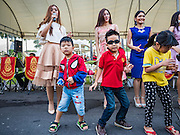 09 JANUARY 2016 - BANGKOK, THAILAND: Children dance during a free concert during Children's Day festivities at Government House. National Children's Day falls on the second Saturday of the year. Thai government agencies sponsor child friendly events and the military usually opens army bases to children, who come to play on tanks and artillery pieces. This year Thai Prime Minister General Prayuth Chan-ocha, hosted several events at Government House, the Prime Minister's office.     PHOTO BY JACK KURTZ