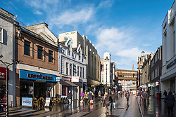 View along Murraygate pedestrian street towards Wellgate shopping centre in Dundee, Scotland, United Kingdom