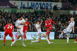 Daniel Sturridge of Liverpool shoots - Photo mandatory by-line: Rogan Thomson/JMP - 07966 386802 - 16/03/2015 - SPORT - FOOTBALL - Swansea, Wales — Liberty Stadium - Swansea City v Liverpool - Barclays Premier League.
