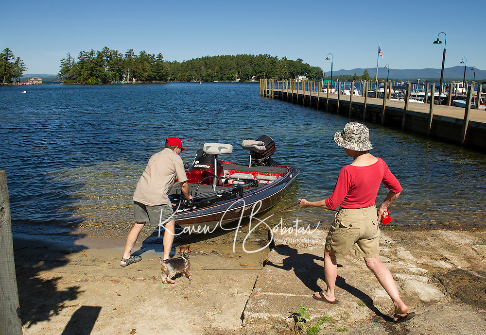 """John and Elise Knowlton with their dog Bentlie launch their boat from Glendale for a """"last day of summer"""" cruise with fishing, book reading and relaxing on their agenda.  (Karen Bobotas/for the Laconia Daily Sun)"""