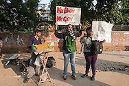 "29th Dec. 2012. Young women hold signs above their heads in Delhi, reading ""My Body My Right / My City My Right"" and ""Only Two Women Safe in Dil (Delhi) / Sonia Gandhi Sheila Dixit (Dikshit) / Shame"". Earlier that day news broke of the death of a victim of gang-rape"