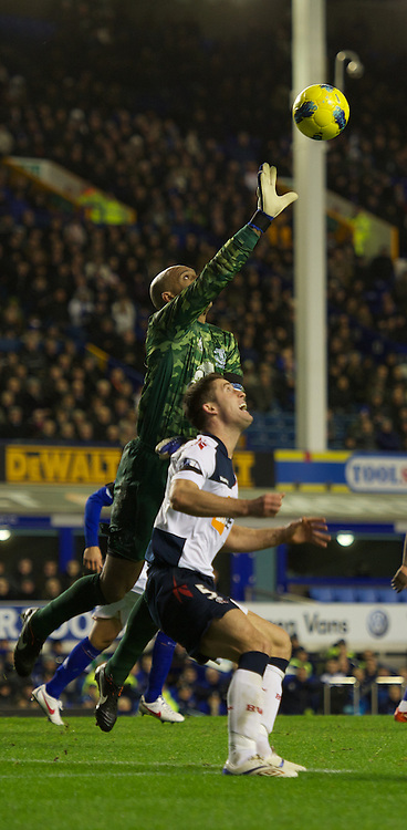 LIVERPOOL, ENGLAND - Wednesday, January 4, 2012: Everton's goalkeeper Tim Howard in action against Bolton Wanderers' Gary Cahill during the Premiership match at Goodison Park. (Pic by David Rawcliffe/Propaganda)