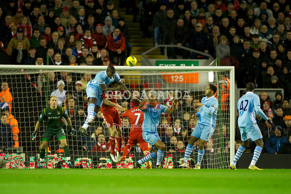 LIVERPOOL, ENGLAND - Sunday, November 27, 2011: Liverpool's Jose Enrique in action against Manchester City's Micah Richards during the Premiership match at Anfield. (Pic by David Rawcliffe/Propaganda)