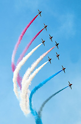 © Licensed to London News Pictures. 18/07/2014, UK. Royal Air Force Red Arrows Display Team, Farnborough International Airshow, Farnborough Airport UK, 18 July 2014,. Photo credit : Richard Goldschmidt/Piqtured/LNP