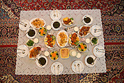 Lunch for family and guests at the home of Atefeh Fotowat, a high school student and aspiring fashion designer in Isfahan, Iran. (Atefeh Fotowat is featured in the book What I Eat: Around the World in 80 Diets.)