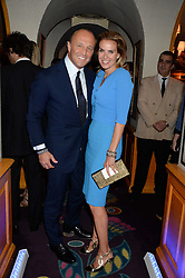 GLENN SPIRO and his wife ARABELLA at the launch of Bluehouse, Samsung's Exclusive New members Club held at Annabel's, 44 Berkeley Square, London on 1st July 2013.