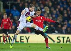CARDIFF, WALES - Tuesday, February 11, 2014: Cardiff City's Fraizer Campbell in action against Aston Villa's captain Ron Vlaar during the Premiership match at the Cardiff City Stadium. (Pic by David Rawcliffe/Propaganda)