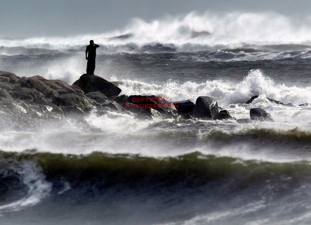 ". ""Surf and Turf""- A turbulent sea, aided by the offshore Hurricane Isabel, pounds the coast of Westport, Massachusetts. fragm..."