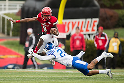 Louisville quarterback Lamar Jackson, left, hurdles Kentucky defensive back Blake McClain in the first half. The University of Louisville hosted Kentucky, Saturday, Nov. 26, 2016 at Papa John's Cardinal Stadium in Louisville. Kentucky won the game 41-38.