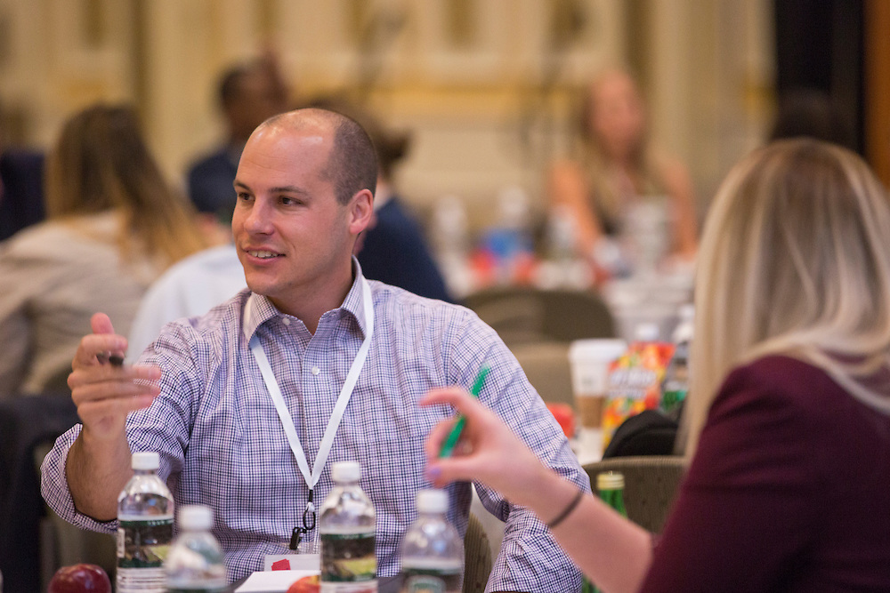 Shawn Martin, of Cleveland, Ohio and an attendee of the Leadership Development Program event, talks to others at his table about effective communication practices in business during Patrick Donadio's presentation in Baker Ballroom on August 26, 2016. Photo by Emily Matthews