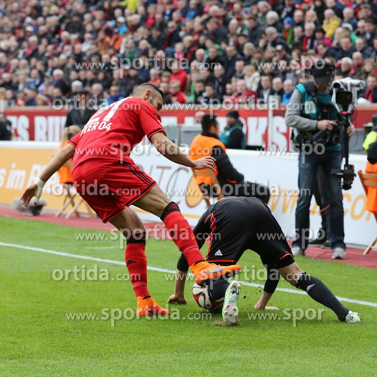 04.04.2015, BayArena, Leverkusen, GER, 1. FBL, Bayer 04 Leverkusen vs Hamburger SV, 27. Runde, im Bild Oemer Toprak (Bayer 04 Leverkusen #21) tritt gegen Ivo Ilicevic (Hamburger SV #11) nach // during the German Bundesliga 27th round match between Bayer 04 Leverkusen and Hamburger SV at the BayArena in Leverkusen, Germany on 2015/04/04. EXPA Pictures &copy; 2015, PhotoCredit: EXPA/ Eibner-Pressefoto/ Sch&uuml;ler<br /> <br /> *****ATTENTION - OUT of GER*****