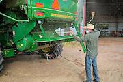 Altus area farm owner John Barrett cleaing a 2014 John Deere combine in the morning before harvesting wheat on his farm near Martha, Oklahoma.