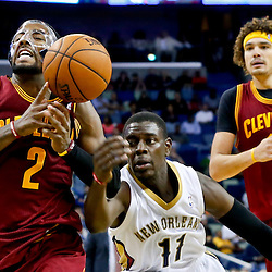 Nov 22, 2013; New Orleans, LA, USA; New Orleans Pelicans point guard Jrue Holiday (11) knocks the ball away from Cleveland Cavaliers point guard Kyrie Irving (2) during the second half of a game at New Orleans Arena. The Pelicans defeated the Cavaliers 104-100. Mandatory Credit: Derick E. Hingle-USA TODAY Sports
