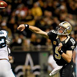 December 30, 2012; New Orleans, LA, USA; New Orleans Saints quarterback Drew Brees (9) throws against the Carolina Panthers during the second half of a game at the Mercedes-Benz Superdome. The Panthers defeated the Saints 44-38. Mandatory Credit: Derick E. Hingle-USA TODAY Sports