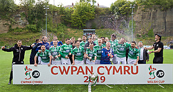 RHOSYMEDRE, WALES - Sunday, May 5, 2019: The New Saints players celebrate by spraying Champagne after the FAW JD Welsh Cup Final between Connah's Quay Nomads and The New Saints at The Rock. The New Saints won 3-0. Wayne Peters, Tom Holland, Chris Marriott, Danny Redmond, Blaine Hudson, captain goalkeeper Paul Harrison, Kane Lewis, Greg Draper, Ryan Brobbel, Mike Harris, Steve Evans. (Pic by David Rawcliffe/Propaganda)