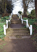 White posts and steps in bright spring sunshine