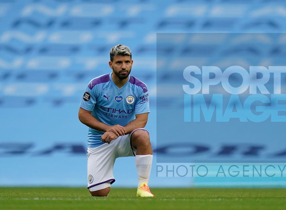 Sergio Aguero of Manchester City takes a knee before the start of the game during the Premier League match at the Etihad Stadium, Manchester. Picture date: 22nd February 2020. Picture credit should read: Andrew Yates/Sportimage