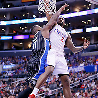 06 January 2014: Los Angeles Clippers center DeAndre Jordan (6) dunks the ball over Orlando Magic power forward Glen Davis (11) during the Los Angeles Clippers 101-81 victory over the Orlando Magic at the Staples Center, Los Angeles, California, USA.