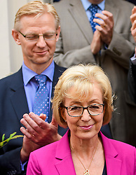 © Licensed to London News Pictures. 11/07/2016. London, UK. Conservative party leadership contender ANDREA LEADSOM MP stands in front of her husband BEN LEADSOM as she delivers a statement in Westminster  In which she pulled out of the leadership race.  Photo credit: Ben Cawthra/LNP