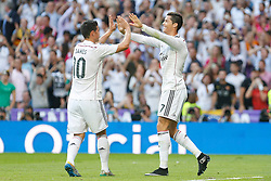 25.10.2014, Estadio Santiago Bernabeu, Madrid, ESP, Primera Division, Real Madrid vs FC Barcelona, 9. Runde, im Bild Real Madrid&acute;s Cristiano Ronaldo celebrates a goal with James // during the Spanish Primera Division 9th round match between Real Madrid CF and FC Barcelona at the Estadio Santiago Bernabeu in Madrid, Spain on 2014/10/25. EXPA Pictures &copy; 2014, PhotoCredit: EXPA/ Alterphotos/ Victor Blanco<br /> <br /> *****ATTENTION - OUT of ESP, SUI*****
