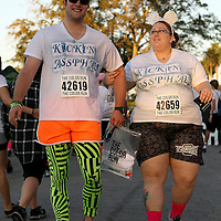 "Participants of the Color Run Orlando as seen prior to the event.  Billed as the ""Happiest 5K on the Planet,? the Color Run is a family-friendly run for those who don't mind getting dust thrown at them after beginning the race with a plain white t-shirt on. This is the first event of the season and occured at the Citrus Bowl in downtown Orlando, Florida on January 13, 2013. (AP Photo/Alex Menendez)"