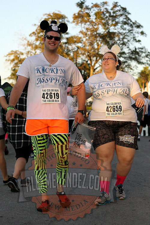 """Participants of the Color Run Orlando as seen prior to the event.  Billed as the """"Happiest 5K on the Planet,? the Color Run is a family-friendly run for those who don't mind getting dust thrown at them after beginning the race with a plain white t-shirt on. This is the first event of the season and occured at the Citrus Bowl in downtown Orlando, Florida on January 13, 2013. (AP Photo/Alex Menendez)"""