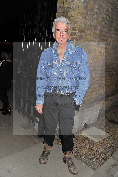 NICKY HASLAM at a party hosted by Ines de la Frssange and Bruno Frisoni for Roger Vivier to launch the Roger Vivier book held at The Saatchi Gallery, London on 24th April 2013.