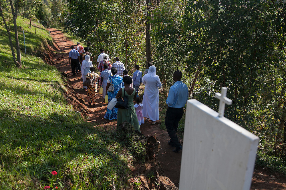 Pilgrims from Kigali pray the rosary at the Shrine of Our Lady of Sorrows in Kibeho, Rwanda. The Virgin Mary appeared here in 1981to three young women. This the only sanctioned Marian sanctuary in Africa. Kibeho's overseers and the Rwandan government hope this place will become a top tourism site.<br /> <br /> Photographed, Sunday, October 26, 2014.<br /> <br /> Photo by Laura Elizabeth Pohl