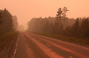 The setting sun turned the smoke from the Sleeping Lake forest fire that was blowing across M-407 a glowing orange  The fire, north of Newberry in the upper peninsula, has been burning an average of 5,000 acres a day.