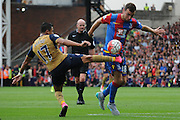 Alexis Sanchez challenging James McArthur during the Barclays Premier League match between Crystal Palace and Arsenal at Selhurst Park, London, England on 16 August 2015. Photo by Michael Hulf.
