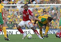 Photo: Ashley Pickering.<br /> Norwich City v Bristol City. Coca Cola Championship. 20/10/2007.<br /> Marvin Elliott of Bristol (no. 25) gets the better of Darel Russell of Norwich