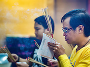 01 JANUARY 2016 - BANGKOK, THAILAND:         People pray in Wat Hua Lamphong in Bangkok on New Year's Day. Thais usually go to temples and religious observances to meditate and make merit on New Year's Day.    PHOTO BY JACK KURTZ