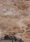 DIQING, CHINA - SEPTEMBER 09: <br /> <br /> Aerial view of tourists visiting the roaring river at Tiger Leaping Gorge scenic spot on September 9, 2016 in Diqing Tibetan Autonomous Prefecture, Yunnan Province of China. At a maximum depth of approximately 3,790 meters (12,434 feet) from river to mountain peak, Tiger Leaping Gorge is one of the deepest and most spectacular river canyons in the world. <br /> ©Exclusivepix Media