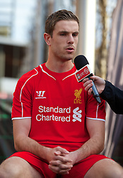 LIVERPOOL, ENGLAND - Thursday, April 10, 2014: Liverpool's Jordan Henderson at the launch the new Warrior home kit for 2014/2015 at the Liverpool One shopping centre. (Pic by David Rawcliffe/Propaganda)