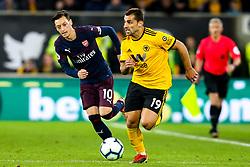 Jonny of Wolverhampton Wanderers goes past Mesut Ozil of Arsenal - Mandatory by-line: Robbie Stephenson/JMP - 24/04/2019 - FOOTBALL - Molineux - Wolverhampton, England - Wolverhampton Wanderers v Arsenal - Premier League