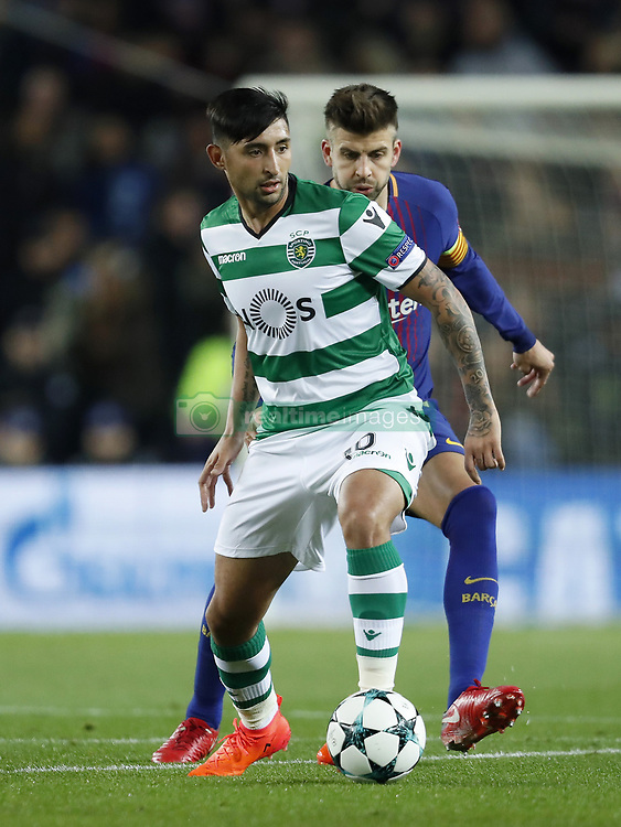 (L-R) Alan Ruiz of Sporting Club de Portugal, Gerard Pique of FC Barcelona during the UEFA Champions League group D match between FC Barcelona and Sporting Club de Portugal on December 05, 2017  at the Camp Nou stadium in Barcelona, Spain.